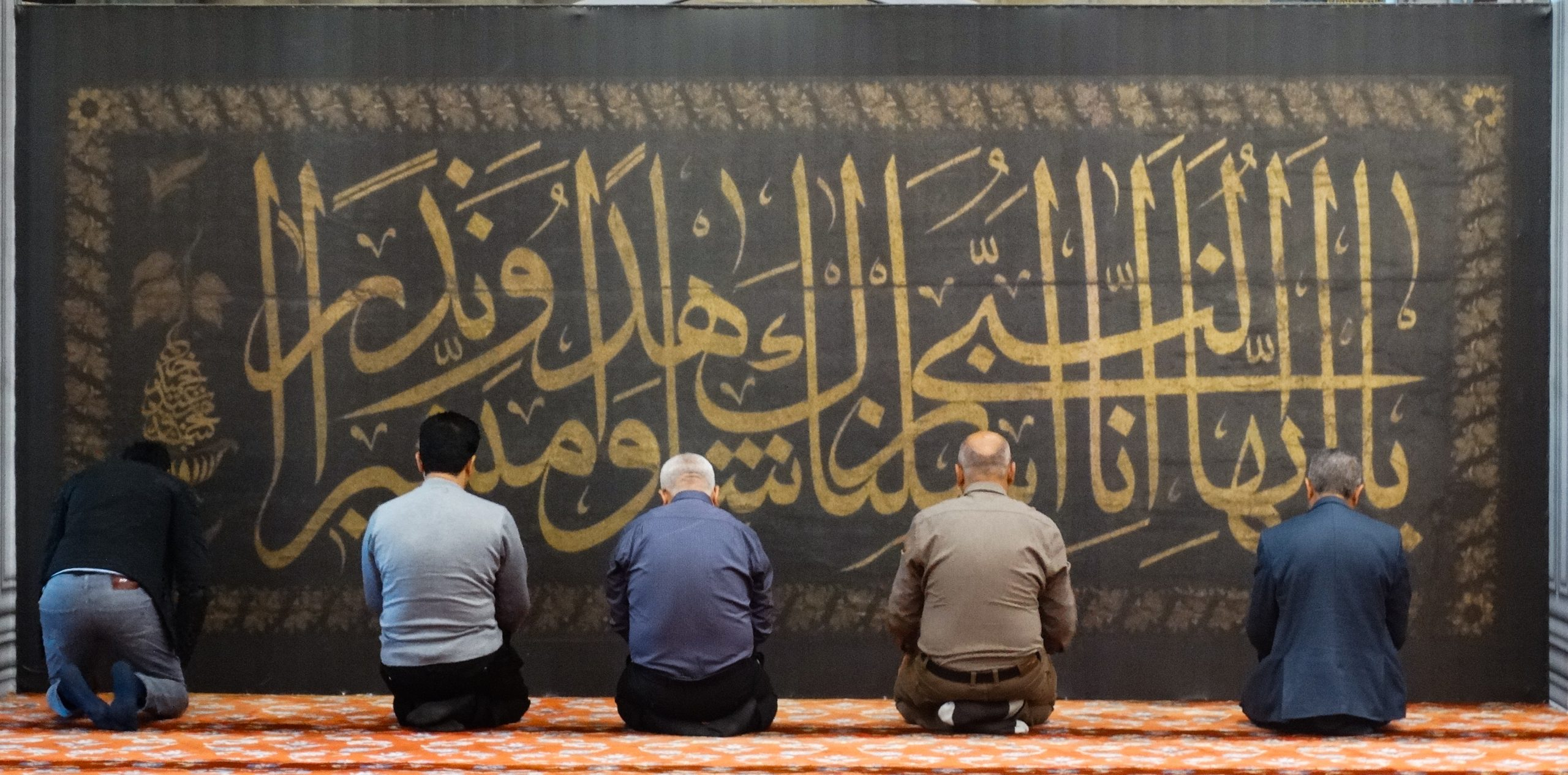Men Praying in the Blue Mosque in Istanbul