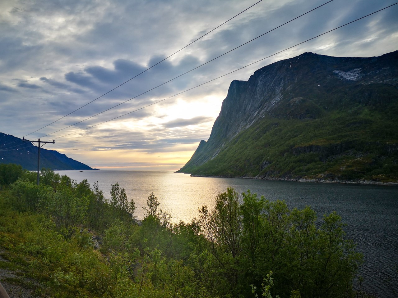 Senja, Norway - Cycling along the edge of a fjord